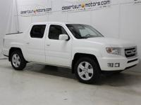 Check out this 2011 Honda Ridgeline with only 36651