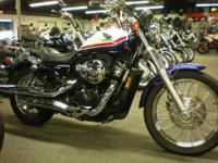 2011 Honda Shadow RS VT750RS in red white and blue.