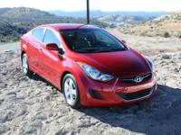 4D Sedan and FWD. You win! Oh yeah!   This 2011 Elantra
