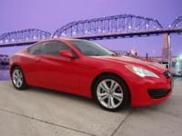 Our 2011 2.0T Genesis Coupe in Tsukuba Red is sleek,