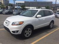 Outstanding Hyundai Santa Fe with Low Miles. This SUV