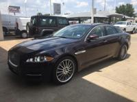 We are excited to offer this 2011 Jaguar XJ. This