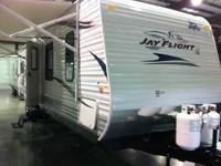 2011 Jayco Jay Flight G2. With its predominantly white