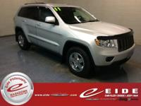 This 2011 Jeep Grand Cherokee Laredo is Bright Silver