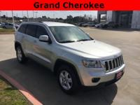 2011 Jeep Grand Cherokee in Silver exterior and Dark