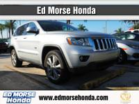 This outstanding example of a 2011 Jeep Grand Cherokee