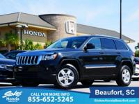 2011 Jeep Grand Cherokee in Black. 4WD. Hugs the road.