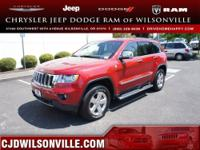 This 2011 Grand Cherokee Overland has less than 13k