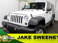 Our 2011 Jeep Wrangler Unlimited Sport 4x4 shown in