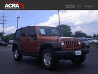 This 2011 Jeep Wrangler Unlimited 4WD 4dr Sport, Stock