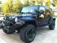 This is a 2011 JKU Sahara. It has approximately 29589mi