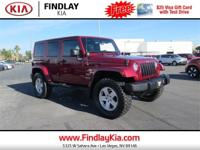 Clean CARFAX. Red 2011 Jeep Wrangler Unlimited Sahara