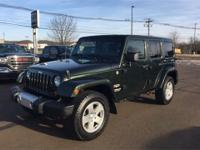 Clean CARFAX. Green 2011 Jeep Wrangler Unlimited Sahara