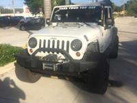 This 2011 Jeep Wrangler Unlimited Sport is proudly