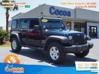 This 2011 Jeep Wrangler Unlimited Sport in Black