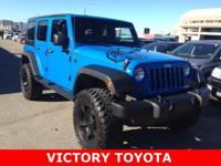 2011 Jeep Wrangler Unlimited Sport in Blue starred