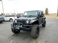 Options:  2011 Jeep Wrangler Unlimited Sport