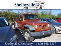 Orange 2011 Jeep Wrangler Unlimited Sport RHD 4WD