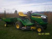 2011 john deere d100 riding lawn mower and dump cart.