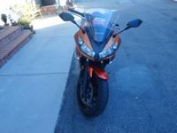 2011 Kawasaki Ninja 650 in Candy Burnt Orange .