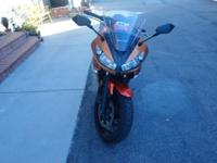 2011 Kawasaki Ninja 650 in Candy Burnt Orange .