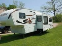 2011 Keystone Cougar. Experience the unique decorative