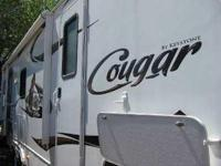 2011 Keystone Cougar. Considered to be fully self