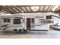 Immaculate 2011 Montana 5th Wheel 3665E. Owner was