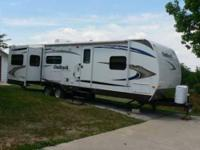 2011 Keystone Outback model 295RE Travel Trailer with