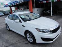 This 2011 Kia Optima 4dr LX Sedan . It is equipped with