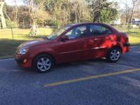 This 2011 Kia Rio 4dr 4dr Sedan. It is geared up with a