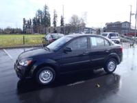 This Black 2011 Kia Rio Base might be just the 4 dr