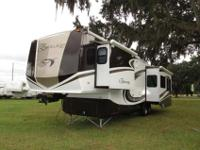A 39' Fifth Wheel with 3 slide-outs, keyless entry and