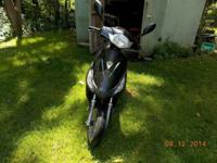 This is a large frame 50cc Moped / Scooter. It has duel