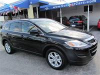 This 2011 Mazda CX-9 Sport SUV features a 3.7L V6 DOHC