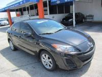 This 2011 Mazda MAZDA3 4dr i Touring Sedan features a