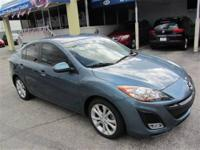 This 2011 Mazda MAZDA3 4dr s Sport Sedan features a
