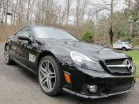 2011 MERCEDES BENZ SL63 AMG WITH 18,570 MILES. This