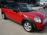 2011 Mini Cooper Clubman finished in Chili Red, 6-Speed