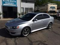 This Mitsubishi Lancer is a perfect little car for