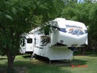 MONTANA 3665RE REAR ENTERTAINMENT QUAD SLIDE 5TH WHEEL
