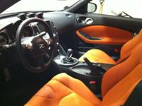 Black exterior with charred orange interior. 6-Speed