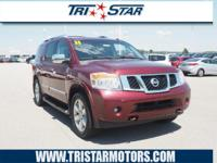 This 2011 Nissan Armada Platinum features a backup