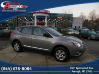 This is a 2011 Nissan Rogue S that is Platinum Graphite