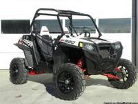 This is a 2011 Polaris RZR XP900 for sale. This unit