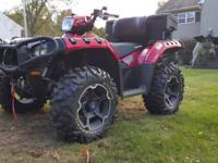 I am selling a 2011 Polaris Sportsman 850XP with