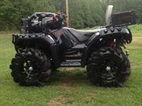 This is a 2011 Polaris sportsman 850 XP Limited Edition