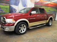 *Rule the roads in this deep red & gold 2011 Ram 1500