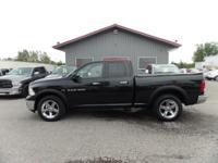 Meet our 2011 Dodge Ram Quad Cab 1500 4X4. This is a