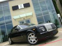 This is a Rolls-Royce Phantom Drophead Coupe for sale